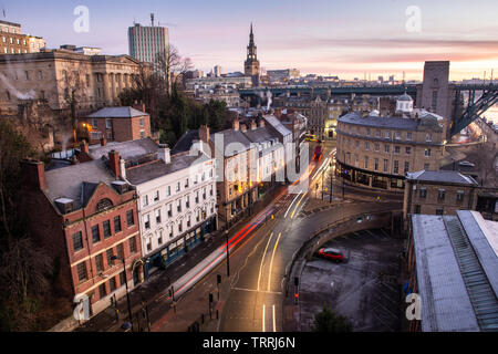 Newcastle, England, UK - February 5, 2019: Traffic flows along the streets of Newcastle during the rush hour on a frosty winter morning. - Stock Image