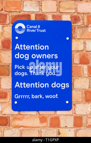 Canal Trust sign for dog owners to clean up after thier dog. Also written in dog. Town lock on the River Trent, Newark on Trent, Nottinghamshire, - Stock Image