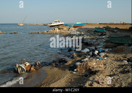 Environment of the Red Sea. Mountains of garbage on the beach away from the resort towns of Egypt - Stock Image