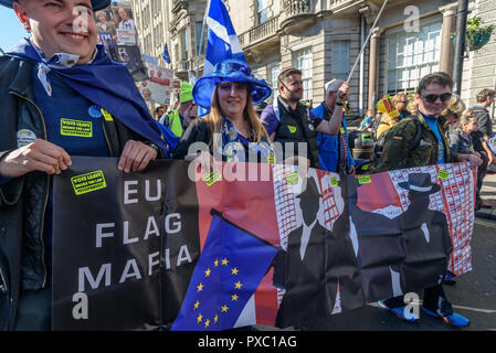 London, UK. 20th October 2018. People carry a 'EU Flag Mafia' banner on the People's Vote March calling for a vote to give the final say on the Brexit deal or failure to get a deal as the march leaves Hyde Park Corner. They say the new evidence which has come out since the referendum makes it essential to get a new mandate from the people to leave the EU. Peter Marshall/Alamy Live News - Stock Image