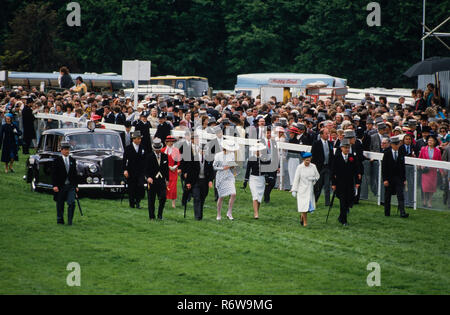 The Derby Horse Race on Epsom Downs, England. 1986, scanned 2018 The 1986 Epsom Derby was a horse race which took place at Epsom Downs on Wednesday 4 June 1986. It was the 207th running of the Derby, and it was won by Shahrastani. The winner was ridden by Walter Swinburn and trained by Michael Stoute. Derby day attended by the British Royal family and members of the public who enjoyed a nice picnic. - Stock Image
