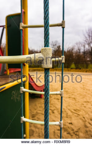 Close up of a blue rope ladder of a climb equipment at a playground. - Stock Image