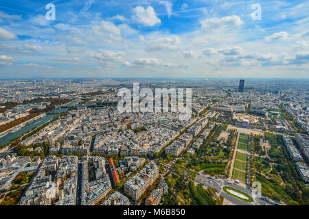 A view of Paris France from the Eiffel Tower in early autumn with the Seine, Champ du Mars, and Montparnasse Tower - Stock Image
