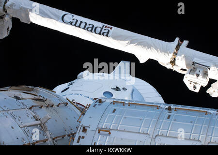 The unmanned SpaceX Dragon commercial crew capsule is docked with the Harmony module on the International Space Station March 4, 2019 in Earth Orbit. The test flight of the unmanned spacecraft to the International Space Station is the first commercial crew test and the start of a new era for NASA space travel. - Stock Image