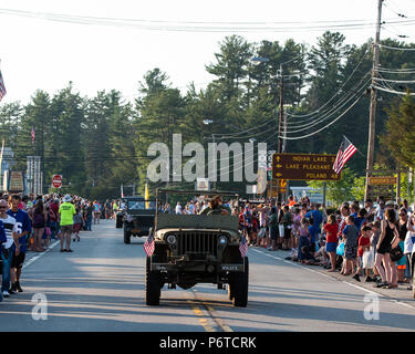 A line of World War II vintage military Jeeps in the 4th of July parade in Speculator, NY USA held on June 30, 2018. - Stock Image