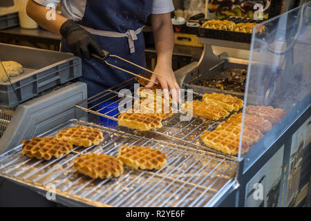 Woman baking traditional Brussels waffles - Stock Image