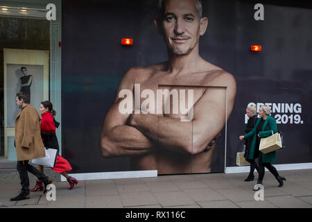 The ex-England footballer, now BBC TV football presenter Gary Lineker appears large on a construction hoarding in Oxford Street, on 5th March 2019, in London, England. - Stock Image