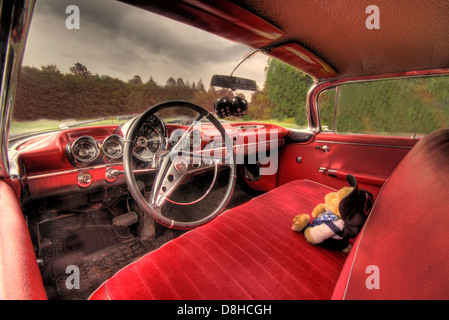 Red Chevy Impala classic automobile car interior - Stock Image