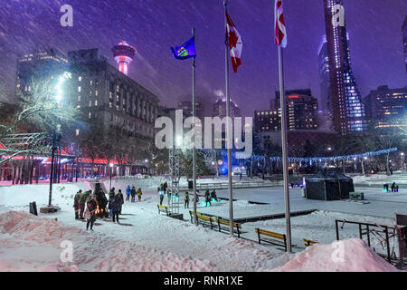 Snowy winter night at the Calgary Olympic Plaza fire pit. Alberta Canada - Stock Image