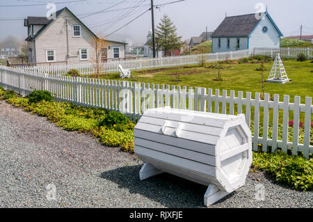 These boxes are used throughout Newfoundland to store bags of domestic rubbish for collection as traditional bins are blown away in the high winds. - Stock Image