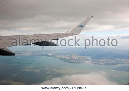Southampton UK Aerial view of the Solent, the Isle of Wight with Cowes and the River Medina with the wingtip of a KLM Embraer taking off from Southamp - Stock Image