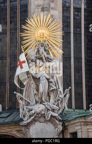 Statue with flag, St Stephen's Cathedral, Vienna, Austria - Stock Image