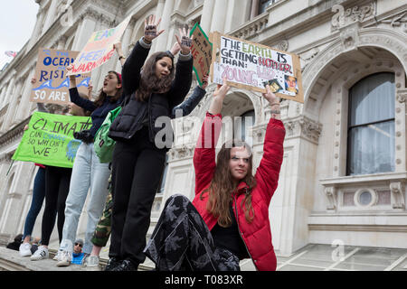 Inspired by Swedish teenager Greta Thunberg and organised by Youth Strike 4 Climate, British eco-aware school and college-age pupils protest about Climate Change inaction in Whitehall during their walkout from classes, on 15th March 2019, in Westminster, London England. - Stock Image