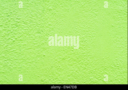 A wall painted lime green as a background texture - Stock Image