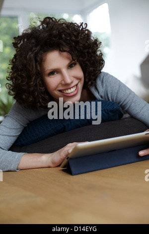 portrait of young woman with tablet computer - Stock Image