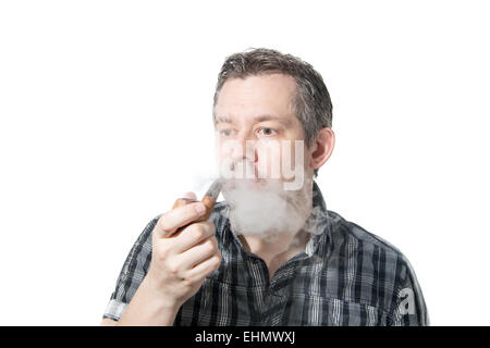 Picture of a man that is smoking on a pipe, while exhaling smoke - Stock Image