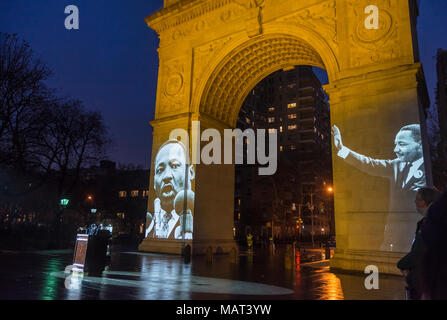 "New York, NY, USA 3 April 2018 The arch in Washington Square Park was lit in orange with images of Dr. Martin Luther King projected on the south side  as a recording of King's speech  ""I've Been to the Mountaintop"" was played, to mark the 50th anniversary of its delivery on the eve of Dr King's assassination. CREDIT ©Stacy Walsh Rosenstock/Alamy Live News - Stock Image"