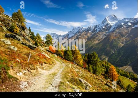 Bietschorn mountain peak in autumn with hiking trail. View from Laucheralp, Loetschental, Wallis, Switzerland - Stock Image