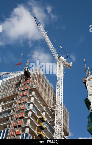 Crane being used in the construction of a new skyscraper. - Stock Image
