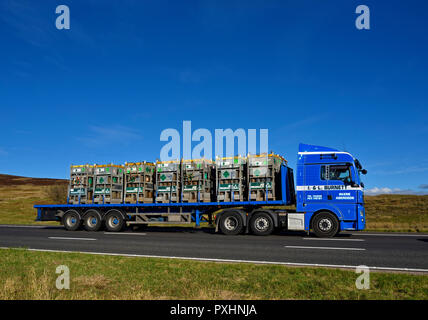 Trailer of Air Products Cylinders hauled by I & L Burnett, Aberdeen HGV. M6 motorway Southbound carriageway, Shap, Cumbria, England, United Kingdom. - Stock Image