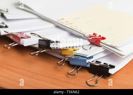 Paper business documents of unfinished stacked on office desk archive,in archive analyzing the market - Stock Image