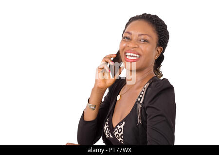 Portrait of happy young woman on the phone isolated on white background. - Stock Image