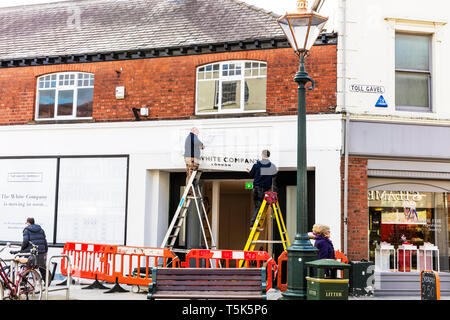 Putting up White Company shop sign, new high street store, high street shop opening, shops opening, new, shop, store, new shop, opening, high street, - Stock Image
