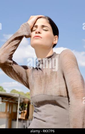 Fashion model posing outdoors. France - Stock Image