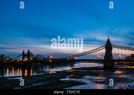Lights on the river at dusk over Hammersmith Bridge, London, UK - Stock Image