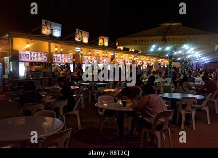 Glutton Bay hawker stalls selling local food, close to Esplanade Wak, Singapore - Stock Image