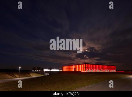 Night - illumination in red with dramatic sky. Carmen Würth Forum, Künzelsau-Gaisbach, Germany. Architect: - Stock Image
