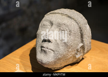 A medieval sculpted head to be seen in the little museum in the chapter house of the Cistercian Jerpoint Abbey, Kilkenny, Ireland - Stock Image
