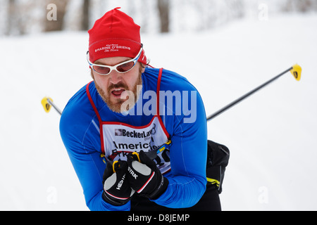 A classic style competitor skis in the American Birkebeiner cross country race in Northern Wisconsin, USA. - Stock Image