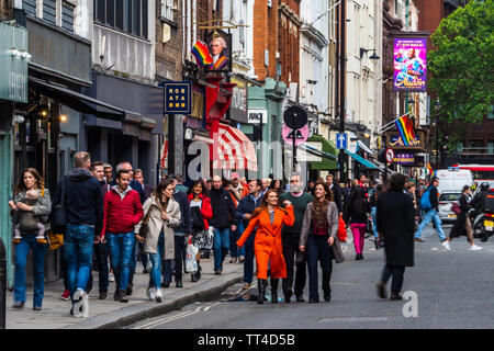 Old Compton Street in the heart of Soho. Soho is traditionally London's entertainment and dining district. - Stock Image