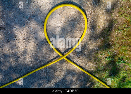 a yellow rubber hose - Stock Image