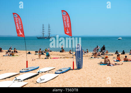 Cascais, Portugal - April 21st, 2019: Standup Paddle boards on beach at a crowded sandy beach in Cascais near Lisbon, Portugal - Stock Image