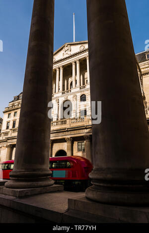Red London bus outside the Bank of England, London, UK - Stock Image