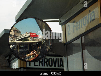 Venetian Pont Scalzi bridge reflected in a mirror at Ferrovia waterbus stop, by the train statin in Venice, italy - Stock Image