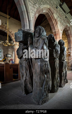 Lindisfarne or Holy Island, Northumberland coast south of Berwick-on-Tweed, England. Parish church of St Mary the Virgin. Carved wooden monks carry co - Stock Image