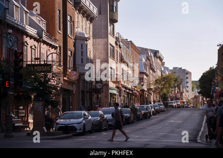 Pedestrian crossing Rue Saint-Jean on a summer evening in old Québec City in the Saint-Jean-Baptiste area of old Québec City, Canada. - Stock Image