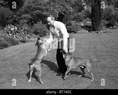 John Surtees with his pet dogs 1966 - Stock Image
