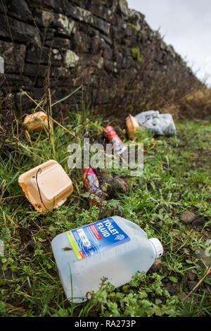 Litter on rural roadside, Northumberland national park, Northumberland, UK - Stock Image