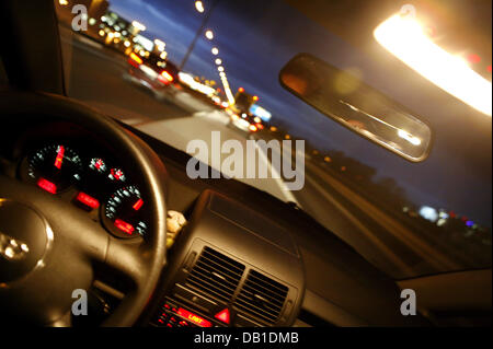 The picture simulates a drunken driver's blurred view of a motorway in Frankfurt Main, Germany, 02 December - Stock Image