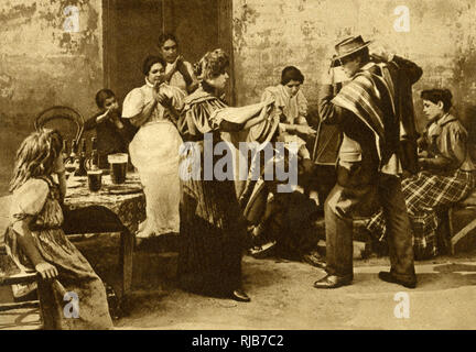 Street scene with dancers, Chile, South America -- they are dancing the national Cueca, performed with hand-clapping, handkerchief waving and musical accompaniment. - Stock Image