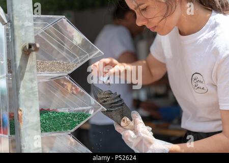 Bournemouth, UK. 24th June, 2018. Black ice cream being made at the vibrant Metropole Mardi Gras street festival in central Bournemouth. A free event on Holdenhurst Road in Lansdowne, including a Mardi Gras parade and live music. Credit Thomas Faull/Alamy Live News. - Stock Image