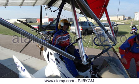 Senior Airman Boone Helm, communication systems operator and technical operator with the 4th Space Operations Squadron, familiarizes himself with a Fly Colorado Ultralights aircraft as part of the Single Airman Initiative program at the Meadow Lake Airport, Falcon, Colorado, Aug. 24, 2018. The SAI program gives single Airmen opportunities to participate in free recreational trips and activities. (U.S. Air Force courtesy photo) - Stock Image