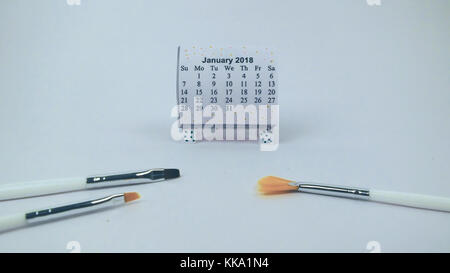 New Year calendar with brush representing new year for  artists best for writers and bloggers - Stock Image
