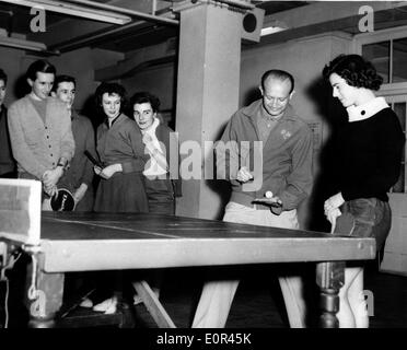 Jan 22, 1958; London, UK; World famous table tennis star VICTOR BARNA has a series of evening sessions in London for likely England representatives in the new European Championships which are being held in Budapest in March. The picture shows Victor Barna showing LYNNE WITHAMS of Kentish Town the correct way of holding her bat, watched by other possible members of the England Teaam, during a coaching sessiion at the Foster Lane Sports Room. Barna is the non-playing captain of the team. - Stock Image