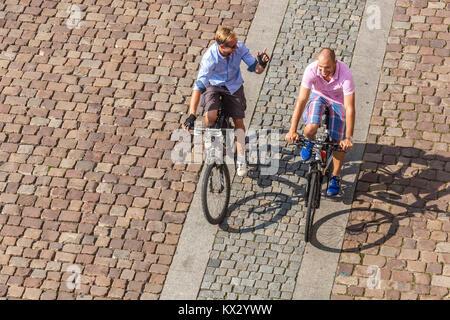 Bikers on the city cycling trail, Prague Naplavka, Czech Republic - Stock Image