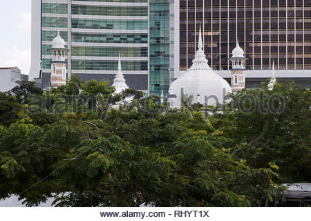 The domes and minarets of the Masjid Jamek the oldest mosque in Kuala Lumpur city centre, Malaysia. - Stock Image